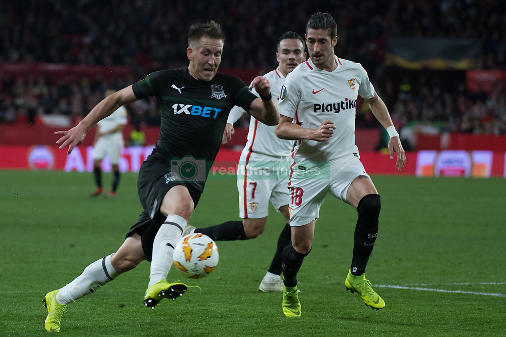 December 13, 2018 - Seville, Andalucia, Spain - Sergio Escudero of Sevilla FC and Petrov of Krasnodar fight for the ball during the Europa League match between Sevilla FC and Krasnodar in Ramón Sánchez Pizjuán Stadium (Seville) (Credit Image: © Javier MontañO/Pacific Press via ZUMA Wire)