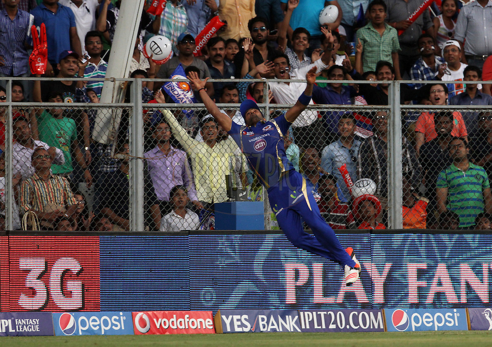 Mumbai Indians player Ranganath Vinay Kumar dives to take a catch during match 23 of the Pepsi IPL 2015 (Indian Premier League) between The Mumbai Indians and The Sunrisers Hyderabad held at the Wankhede Stadium in Mumbai India on the 25th April 2015.<br /> <br /> Photo by:  Vipin Pawar / SPORTZPICS / IPL