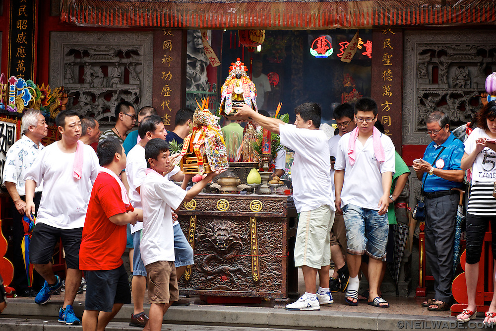 All of the small idols were transported in and out of the small Taoist temple in Tainan, but being carried over the joss incense burner in the front.
