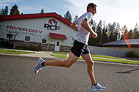 Shannon Horn, CEO of River City Fabrication, uses the street where his business is located to perform speed workouts Tuesday in preparation for an upcoming triathlon.