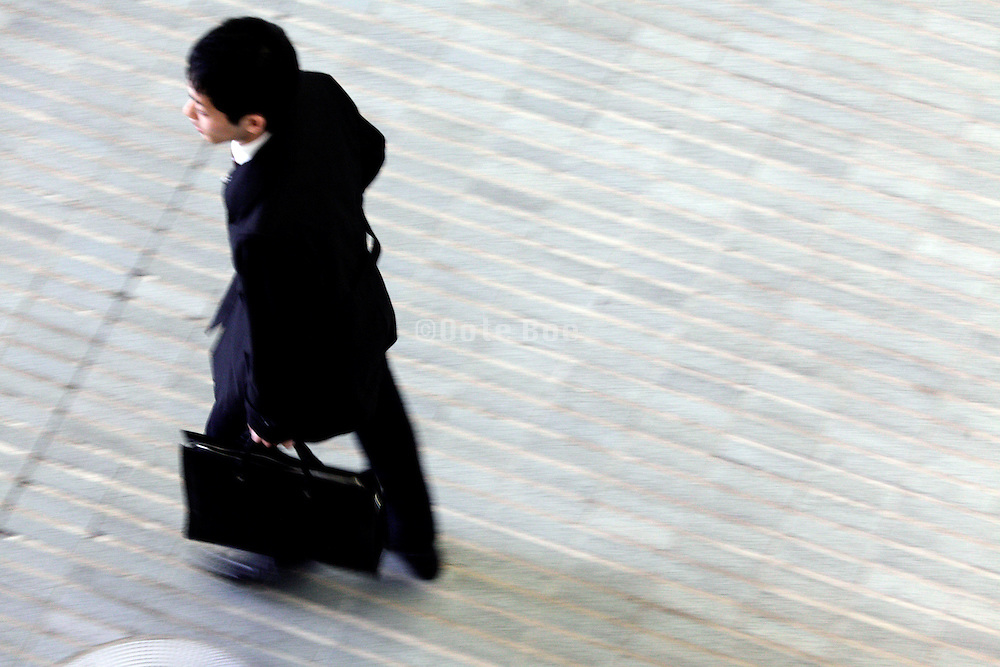 overhead view of young adult businessman walking