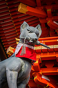 Fushimi Inari shrine is a Shinto shrine dedicated to Inari, the Kami of foxes, fertility, agriculture and industry. All the grounds of this Shinto Shrine have several statues of foxes.