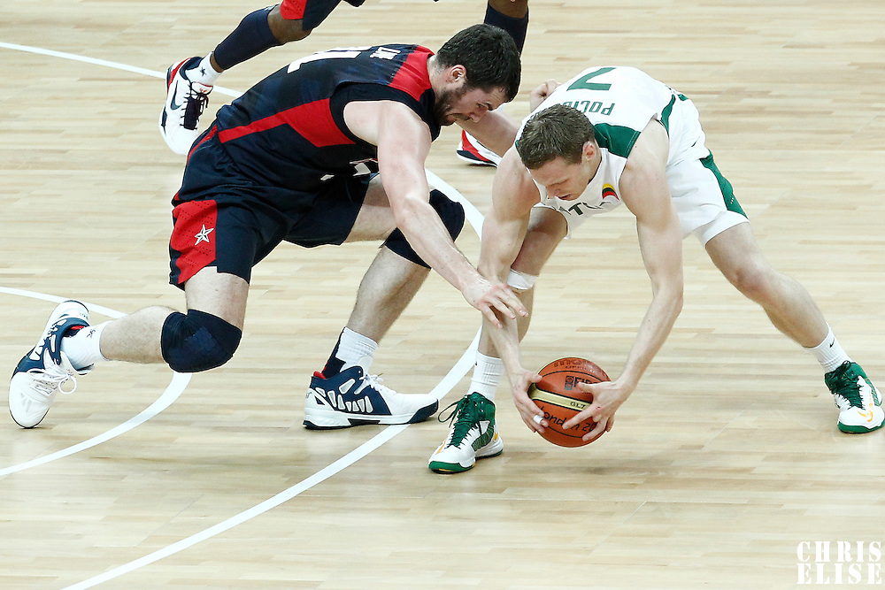 04 August 2012: USA Kevin Love vies for the loose ball with Lithuania Martynas Pocius during 99-94 Team USA victory over Team Lithuania, during the men's basketball preliminary, at the Basketball Arena, in London, Great Britain.
