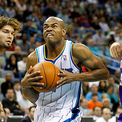 December 30, 2011; New Orleans, LA, USA; New Orleans Hornets point guard Jarrett Jack (2) drives between Phoenix Suns point guard Steve Nash (13) and center Robin Lopez (15) during the first quarter of a game at the New Orleans Arena.   Mandatory Credit: Derick E. Hingle-US PRESSWIRE