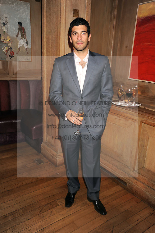 SIMON KASSIANIDES at a party to celebrate the launch of Hollywood Domino - a brand new board game, held at Mosimann's 11b West Halkin Street, London on 7th November 2008.  The evening was in aid of Charlize Theron's Africa Outreach Project.