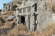 Rock-hewn Lycian tombs, with geometric recessed carved shapes, in the necropolis to the east of the acropolis at Xanthos, Antalya, Turkey. Xanthos was a centre of culture and commerce for the Lycians, and later for the Persians, Greeks and Romans, and was listed as a UNESCO World Heritage Site in 1988. Picture by Manuel Cohen