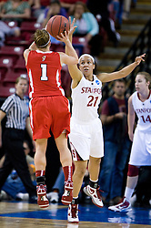 March 27, 2010; Sacramento, CA, USA; Stanford Cardinal guard Rosalyn Gold-Onwude (21) defends Georgia Bulldogs guard Ashley Houts (1) on a shot during the first half in the semifinals of the Sacramental regional in the 2010 NCAA womens basketball tournament at ARCO Arena.  Stanford defeated Georgia 73-36.