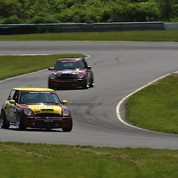 May 23, 2009; Lakeville, CT, USA; The two RSR Motorsports Mini Cooper S cars qualify for the Grand-Am Koni Sports Car Challenge series competition during the Memorial Day Road Racing Classic weekend at Lime Rock Park.