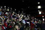 fans make fun of the failing floodlights and use phones and lighters during the Sky Bet League 2 play-off 2nd leg match between Accrington Stanley and AFC Wimbledon at the Fraser Eagle Stadium, Accrington, England on 18 May 2016. Photo by Stuart Butcher.
