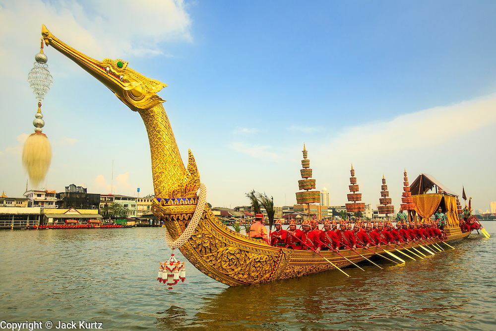 06 NOVEMBER 2012 - BANGKOK, THAILAND:  The Royal Barge Suphannahong on the Chao Phraya River, rowed by 50 oarsmen in the dress rehearsal for the Royal Barge Procession. Thailand's Royal Barge Procession has both religious and royal significance. The tradition is nearly 700 years old. The Royal Barge Procession takes place rarely, typically coinciding with only the most important cultural and religious events. During the reign of King Bhumibol Adulyadej, spanning over 60 years, the Procession has only occurred 16 times. The Royal Barge Procession consists of 52 barges: 51 historical Barges, and the Royal Barge, the Narai Song Suban, which King Rama IX built in 1994. It is the only Barge built during King Bhumibol's reign. These barges are manned by 2,082 oarsmen. The Procession proceeds down the Chao Phraya River, from the Wasukri Royal Landing Place in Bangkok, passes the Grand Palace complex and ends at Wat Arun. Tuesday's dress rehearsal was the final practice for the 2012 Royal Barge Procession, which takes place November 9.       PHOTO BY JACK KURTZ