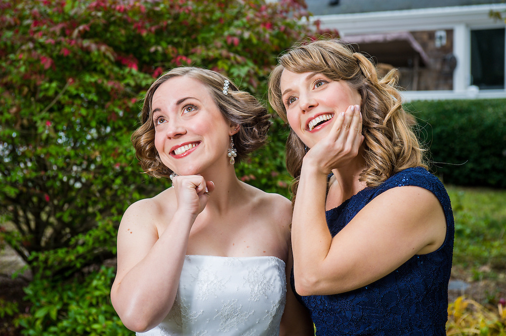 A bride and her sister ham it up in Chatham, MA.