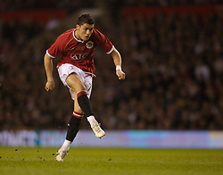 Manchester, England - Tuesday, March 13, 2007: Manchester United's Christiano Ronaldo scores the third goal from a free kick against Europe XI during the UEFA Celebration Match at Old Trafford. (Pic by David Rawcliffe/Propaganda)