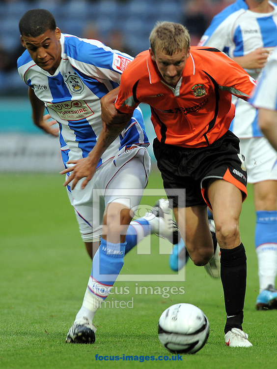 Huddersfield - Tuesday August 11th, 2009: Lee Peltier of Huddersfieldand Carl Baker of Stockport County during the Carling Cup 1st round match at Huddersfield. (Pic by John Rushworth/Focus Images)..