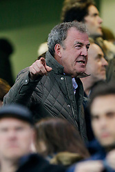 BBC Top Gear Presenter Jeremy Clarkson, suspended this week for allegedly punching a member of his production team, seems puzzled as to why photographers focus on him as he takes his seat in the stands - Photo mandatory by-line: Rogan Thomson/JMP - 07966 386802 - 11/03/2015 - SPORT - FOOTBALL - London, England - Stamford Bridge - Chelsea v Paris Saint-Germain - UEFA Champions League Round of 16 Second Leg.