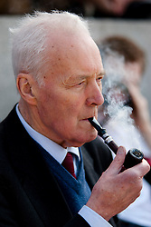 © licensed to London News Pictures. London, UK  01/05/11. Labour politician Tony Benn smokes his pipe as he waits to address several thousand people taking part in a Mayday demonstration in central London. Please see special instructions for usage rates. Photo credit should read Matt Cetti-Roberts/LNP