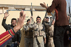Licensed to London News Pictures. 11/11/2016. Mosul, Iraq. Residents and Iraqi soldiers dance to music during a visit to Mosul's Al Antisar district by soldiers of the Iraqi Army's 9th Armoured Division. The Al Intisar district was taken four days ago by Iraqi Security Forces (ISF) and, despite its proximity to ongoing fighting between ISF and ISIS militants, many residents still live in the settlement without regular power and water and with dwindling food supplies.<br /> <br /> The battle to retake Mosul, which fell June 2014, started on the 16th of October 2016 with Iraqi Security Forces eventually reaching the city on the 1st of November. Since then elements of the Iraq Army and Police have succeeded in pushing into the city and retaking several neighbourhoods allowing civilians living there to be evacuated - though many more remain trapped within Mosul.  Photo credit: Matt Cetti-Roberts/LNP