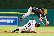 September 13, 2009: #2 Aaron Hill of the Toronto Blue Jays makes the throw to first as #24 Miguel Cabrera of the  Detroit Tigers slides into second during the MLB game between  Toronto Blue Jays and Detroit Tigers at Comerica Park, Detroit, Michigan. Tigers defeated the Jays 7-2.
