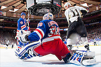 On March 5, 2010, New York Rangers goalie Henrik Lundqvist makes his career high 50th save in a game vs. the Pittsburgh Penguins at Madison Square Garden. Brothers Marc (#18) and Jordan Staal (#11) look on.