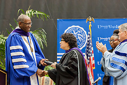 Dr. David Hall awards Justice Sonial Sotomayor with an honorary degree.  2017 Student Convocation with featured honored guest the Honorable Sonia Sotomayor, Associate Justice, United States Supreme Court.  UVI Sports and Fitness Center.  St. Thomas, USVI.  9 February 2017.  © Aisha-Zakiya Boyd