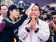 """24 NOVEMBER 2012 - BANGKOK, THAILAND: Gen Boonlert """"Seh Ai"""" Kaewprasit, leader of Pritak Siam and organizer of the anti-government rally, prays during a Brahmin blessing ceremony before a large anti government, pro-monarchy, protest  on November 24, 2012 in Bangkok, Thailand. The Siam Pitak group, which sponsored the protest, cited alleged government corruption and anti-monarchist elements within the ruling party as grounds for the protest. Police used tear gas and baton charges againt protesters.       PHOTO BY JACK KURTZ"""