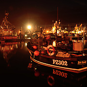 Cornish Fishing boats in Newlyn Harbour. Floating lights.<br />