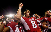 Nov 12, 2011; Fayetteville, AR, USA; <br /> Arkansas Razorback linebacker Matt Marshall (47) quarterback Tyler Wilson (8) cornerback Jerry Mitchell (38) and safety Seth Armbrust (13) sing the school's fight song following a game against the Tennessee Volunteers at Donald W. Reynolds Razorback Stadium. Arkansas defeated Tennessee 49-7. Mandatory Credit: Beth Hall-US PRESSWIRE