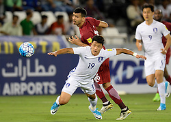 DOHA, June 14, 2017  Hwang Hee Chan (Front) of South Korea vies for the ball with Mohammed Kasoala (R) of Qatar  during their 2018 FIFA World Cup qualification soccer match at the Jassim Bin Hamad Stadium in Doha, capital of Qatar, June 13, 2017. Qatar won 3-2. (Credit Image: © Nikku/Xinhua via ZUMA Wire)