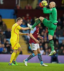 BIRMINGHAM, ENGLAND - Saturday, January 17, 2015: Aston Villa's goalkeeper Brad Guzan and Liverpool's Rickie Lambert during the Premier League match at Villa Park. (Pic by David Rawcliffe/Propaganda)
