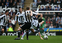 Photo: Andrew Unwin.<br />Newcastle United v Tottenham Hotspur. The Barclays Premiership. 01/04/2006.<br />Tottenham's Robbie Keane (R) is upended by Newcastle's Craig Moore (C).