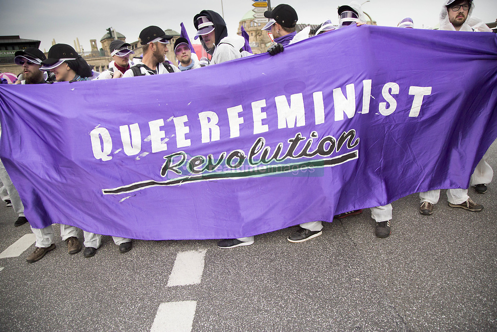 July 7, 2017 - Hamburg, Germany - Protesters hold ''Queerfeminist'' banner during ''Block G20 – Colour the Red Zone'' demonstration during G 20 summit in Hamburg on July 7, 2017. (Credit Image: © Maciej Luczniewski/NurPhoto via ZUMA Press)