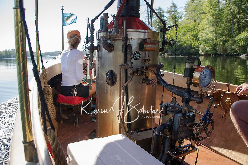 """Kristie and Clem Legates enjoy calm waters on Lake Winnipesaukee in their custom made """"Phoenix"""" steamboat on Wednesday.   (Karen Bobotas/for the Laconia Daily Sun)"""