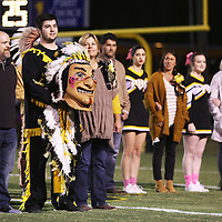 Lauren Wood | Buy at photos.djournal.com<br /> Isaac Caldwell, the Pontotoc warrior mascot, stands with his parents Bart and Tracye Mason as he is recognized during senior night Friday night at Pontotoc High School.