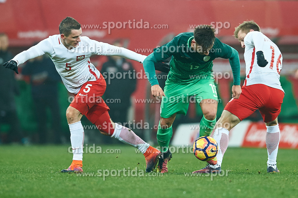 Wroclaw, Poland - 2016 November 14: (C) Andraz Sporar of Slovenia fights for the ball with (L) Krzysztof Maczynski and Jakub Blaszczykowski both of Poland during Poland v Slovenia - International Friendly Soccer Match at Municipal Stadium on November 14, 2016 in Wroclaw, Poland.<br /> <br /> Adam Nurkiewicz declares that he has no rights to the image of people at the photographs of his authorship.<br /> <br /> Picture also available in RAW (NEF) or TIFF format on special request.<br /> <br /> Any editorial, commercial or promotional use requires written permission from the author of image.<br /> <br /> Mandatory credit:<br /> Photo by © Adam Nurkiewicz / Mediasport
