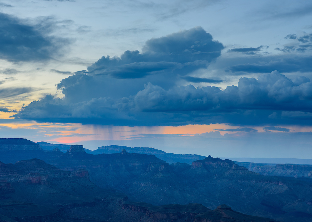 A gentle rain falls on the North Rim during the pre-dawn light.