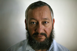 "Rabbi Gideon Bashan, head of a religious school for girls and a resident of the Gush Katif settlements, is seen in Gaza, Palestinian Territories, Nov. 4, 2004. When asked his thoughts about leaving the settlement Bashan has called home for 20 years, he responded, "" We are not losing our self-confidence and I can't think about it. But if they try to move us, I will behave like a wounded animal."" He then added, ""This is not real estate, this is the Holy Land."" Israel's parliament recently supported compensation payments for Jewish settlers leaving the Gaza Strip, in a vital vote for Prime Minister Ariel Sharon's plan to evacuate the occupied territory."