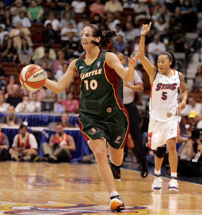 Western Conference All-Star, of the Seattle Storm, Sue Bird reacts after being fouled by Eastern Conference All-Star, of the Charlotte Sting, Dawn Staley, during the first half of the 2005 WNBA All-Star Game in Uncasville, Connecticut Saturday 9 July 2005