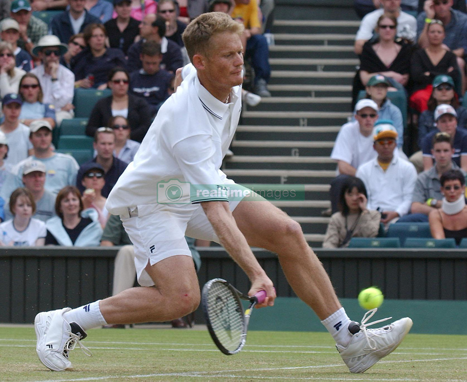 EDITORIAL USE ONLY, NO COMMERCIAL USE. Wayne Ferreira from South Africa in action against Britain's men's singles tennis star Tim Henman on Centre Court at Wimbledon. The winner goes through to the quarter finals.