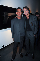 Left to right, GUIDO MOCAFICO and TIM JEFFERIES at a private view of photographs by Guido Mocafico entitled 'Guns and Roses' held at Hamiltons Gallery, 13 Carlos Place, London W1 on 21st January 2010.