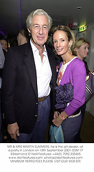MR & MRS MARTIN SUMMERS, he is the art dealer, at a party in London on 18th September 2001.	OSM 17