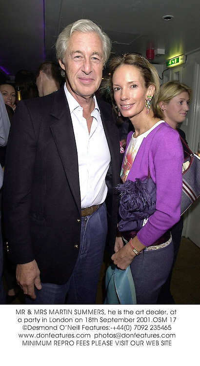 MR & MRS MARTIN SUMMERS, he is the art dealer, at a party in London on 18th September 2001.OSM 17