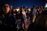 Paris, France - July 14, 2014: A couple enjoys the Bastille Day fireworks from a bridge over the Seine. CREDIT: Chris Carmichael for The New York Times
