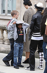 ©London News Pictures. 15/01/2011 .Picture Credit Should read Neil Hall/London News Pictures.Madonna directs her new period film W.E. starring Abbie Cornish about the abdication of King Edward in London on 08/08/2010 Pictured is Madonna with sons david and Rocco