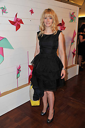 EDITH BOWMAN at a party to celebrate the launch of the Lucy in Disguise Ready to Wear collection exclusive to Harvey Nichols, held at The Fifth Floor Restaurant, Harvey Nichols, Knightsbridge, London on 25th May 2011.