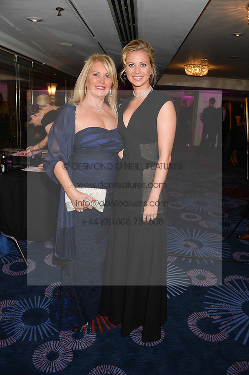 British fine jewellery brand Boodles welcomed guests for the 2013 Boodles Boxing Ball in aid of Starlight Children's Foundation held at the Grosvenor House Hotel, Park Lane, London on 21st September 2013.<br /> Picture Shows:-Left to right, JOAN BRANSON and her daughter HOLLY ANDREWES.<br /> <br /> Press release - https://www.dropbox.com/s/a3pygc5img14bxk/BBB_2013_press_release.pdf<br /> <br /> For Quotes  on the event call James Amos on 07747 615 003 or email jamesamos@boodles.com. For all other press enquiries please contact luciaroberts@boodles.com (0788 038 3003)