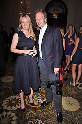 Editor of Tatler KATE REARDON and photographer HUGO BURNAND at the Tatler Restaurant Awards 2011 held at the Langham Hotel, Portland Place, London on 9th May 2011.