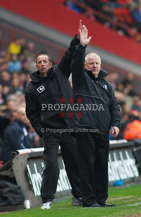 LONDON, ENGLAND - Saturday, March 5, 2011: Tranmere Rovers' Manager Les Parry and his assistant both appeal for the ball during the Football League One match at The Valley. (Photo by Gareth Davies/Propaganda)