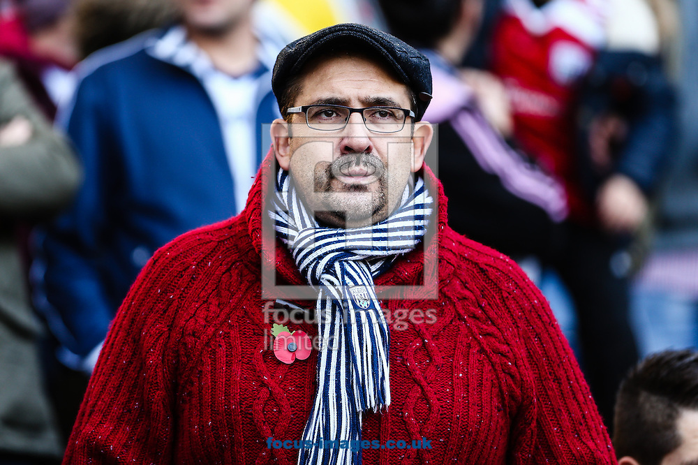West Bromwich Albion fan during The Remembrance Service before the Barclays Premier League match at The Hawthorns, West Bromwich<br /> Picture by Andy Kearns/Focus Images Ltd 0781 864 4264<br /> 09/11/2014