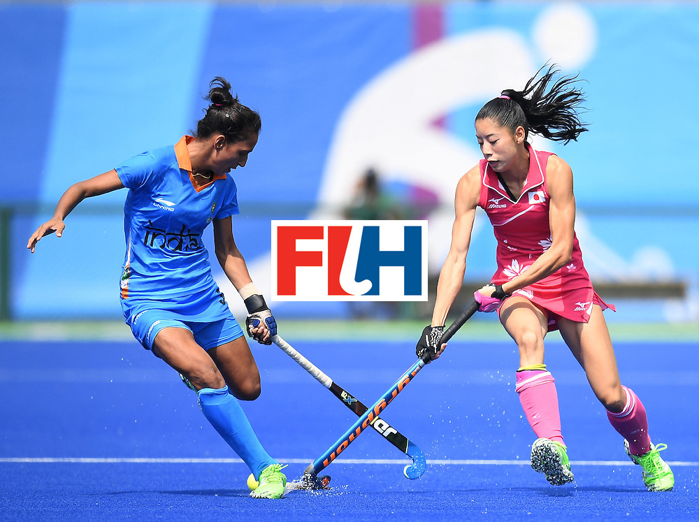 Japan's Hazuki Yuda (R) and India's Preeti Dubey vie for the ball  during the women's field hockey Japan vs India match of the Rio 2016 Olympics Games at the Olympic Hockey Centre in Rio de Janeiro on August, 7 2016. / AFP / MANAN VATSYAYANA        (Photo credit should read MANAN VATSYAYANA/AFP/Getty Images)
