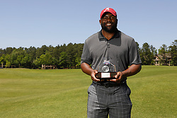 Mark Ingram poses with the trophy after winning the celebrity Closest to the Pin Challenge during the Chick-fil-A Peach Bowl Challenge at the Oconee Golf Course at Reynolds Plantation, Sunday, May 1, 2018, in Greensboro, Georgia. (Paul Abell via Abell Images for Chick-fil-A Peach Bowl Challenge)
