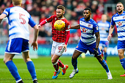 Matt Taylor of Bristol City is challenged by Leandro Bacuna of Reading - Rogan/JMP - 26/12/2017 - Ashton Gate Stadium - Bristol, England - Bristol City v Reading - Sky Bet Championship.